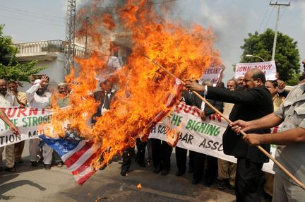 Obama Issues Apology for Mistaken Quran Burning; Americans Still Wait For Apologies over Flag and Bible Burning american flag burning quran afghanistan protest 9eff2d1867e00f8d large