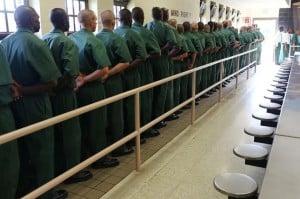 fema-prisoners-boarding-busses-300x199