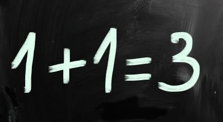"""1+1=3"" handwritten with white chalk on a blackboard"